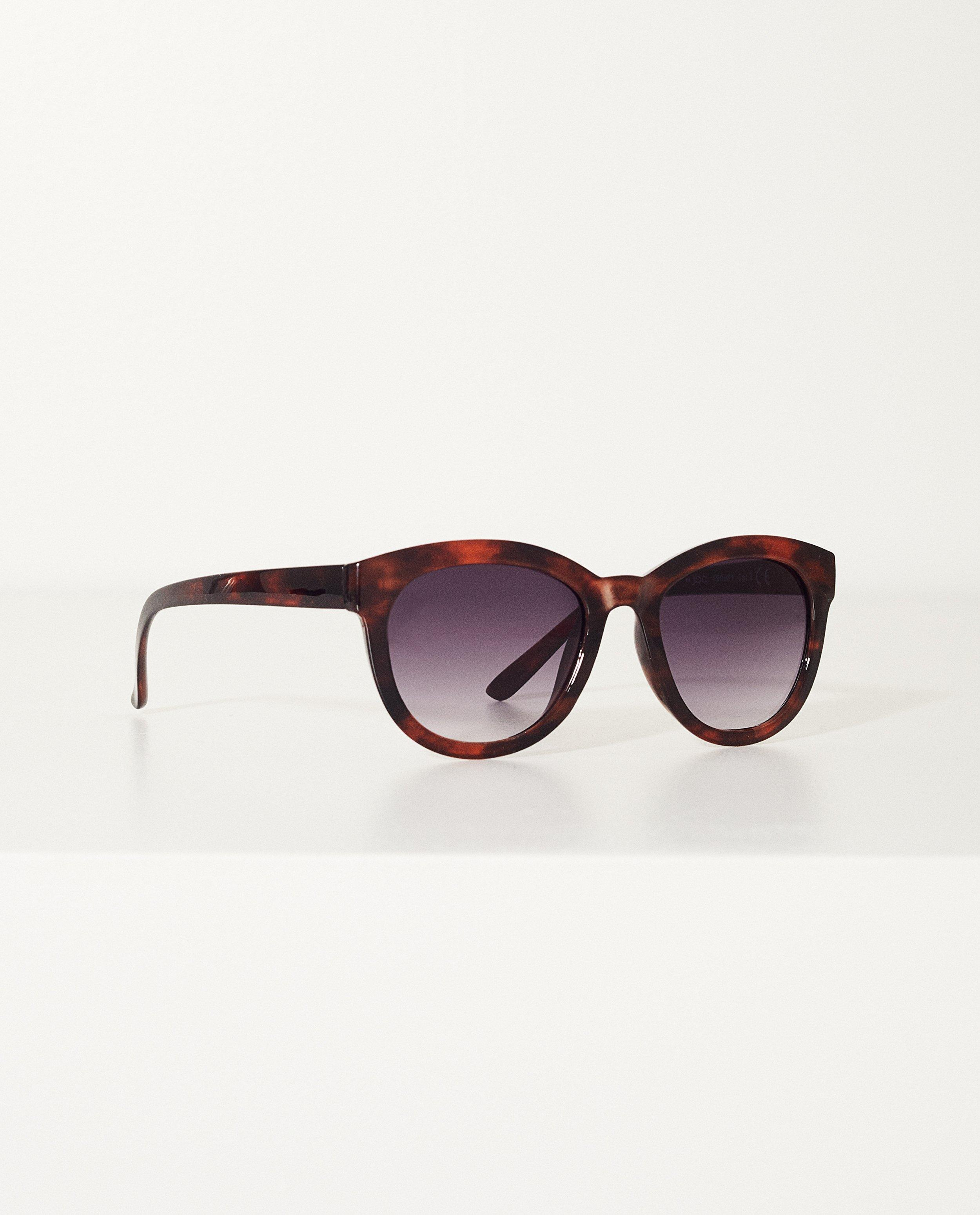 921039e1b3fb30 Bruine zonnebril met dierenprint Met print