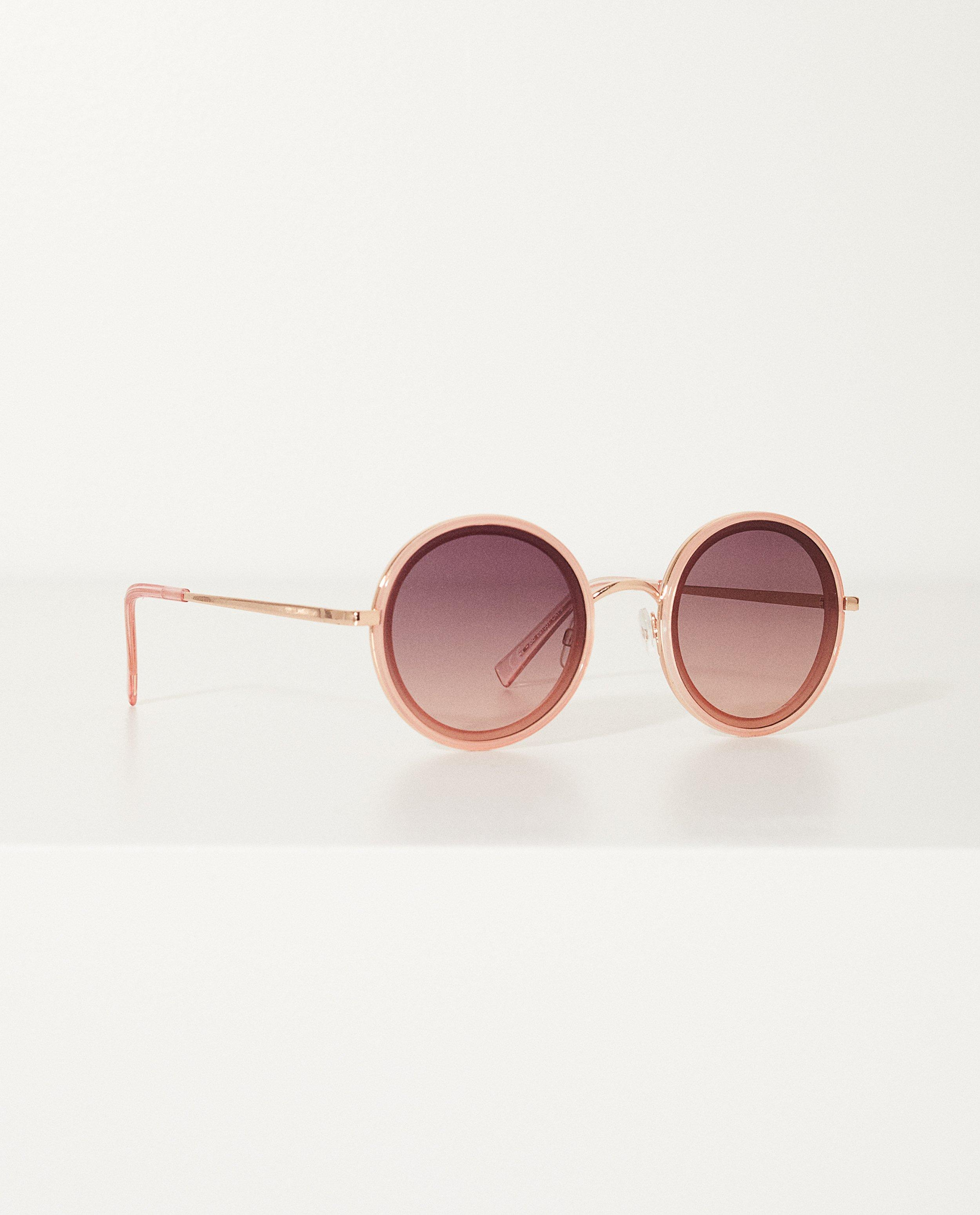 5cb485e1989cca Roze zonnebril Met ronde glazen
