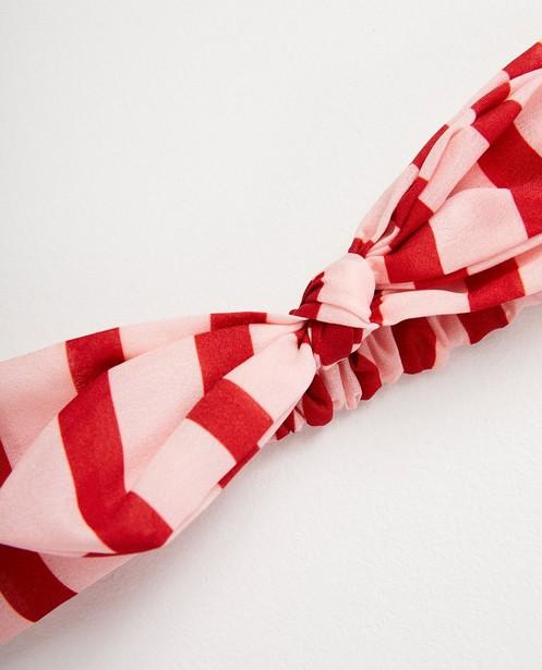 Bonneterie - Bandeau rose avec nœud papillon.