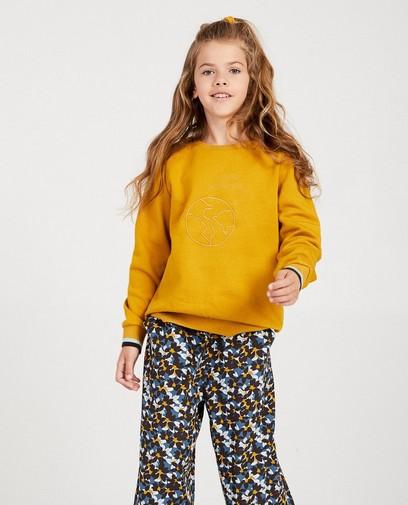 Gele sweater met opschrift I AM
