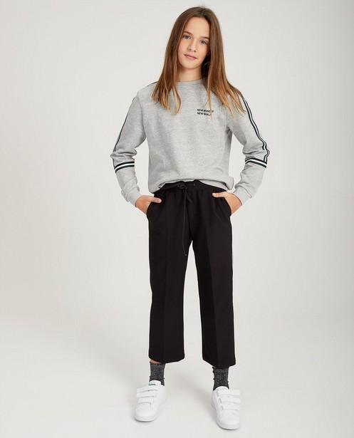 Pantalon noir, rayure blanche - sur le côté - Groggy