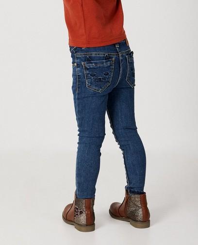 Blauwe jeans met kat detail