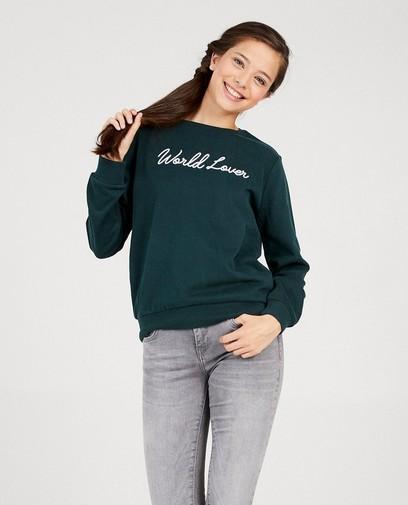 Donkergroene sweater met opschrift