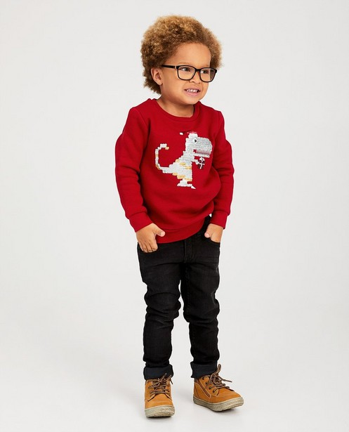 Sweat rouge avec un dino - paillettes swipe - JBC