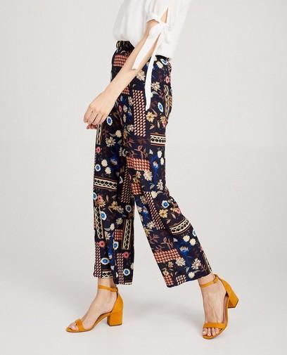 Pantalon bleu, imprimé imposant