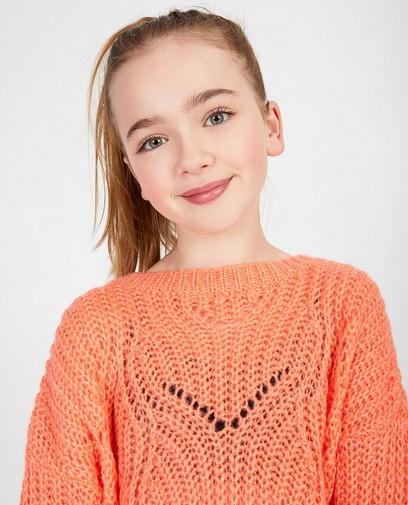 Pull rose vif à motif tricoté