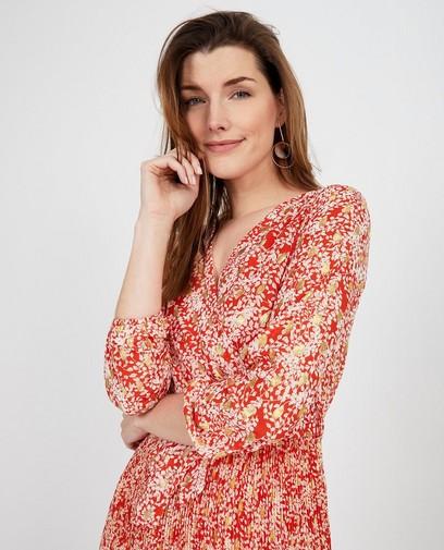 Oranje jurk met bloemenprint