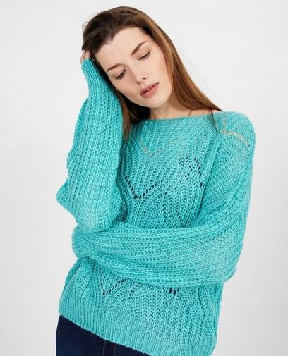 Turquoise trui met ajourpatroon