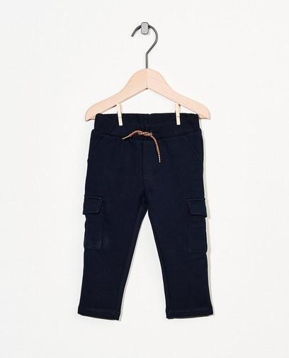 Blauwe broek met klepzakken