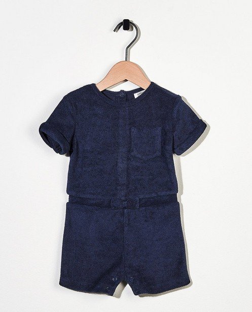 Donkerblauwe jumpsuit van spons - met strikje - Cuddles and Smiles